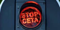 """Overlays on a red light reading, """"Stop CETA"""" are displayed on traffic lights near the European Commission in Brussels, Belgium September 1, 2016. REUTERS/Eric Vidal"""